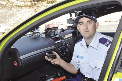 CAUGHT: Senior Constable Wes Bush with one of the many illegal mobile radar detectors seized by police in the last few weeks.