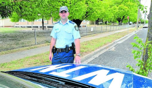 SLOW DOWN: Leading senior constable Wes Bush wants motorists to know Orange Highway Patrol will continue to target speeding in school zones when the school term starts on Tuesday. Photo: JUDE KEOGH. 0124schoolzone1