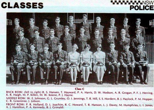 Class 158C - Redfern Police Academy<br /> Back Row: R.S. HANSEN, T. HAYWARD, P.A. HARRIS, D.W. HODSON, ALLAN R. GROGAN, P.F.J. HERRING, K.R. HAIGH, MARTIN P. KILLEN # 17965 ( son of FRANK ), M.W. KEENE, P.J. HAYNE<br /> Middle Row: W.E. ( WAYNE ) JOHNSON, G.L. GRUMLEY, OWEN I. JENNINGS ( RIP ), T.R. HILL, S.S. HORDEN, B.J. HAYLOCK, P.M. HOPPER, C.R. GREENTREE, J. JOBSON<br /> Front Row: P.R.( DUTCHY ) HOLLAND, D.L. JOACHIM ( R.I.P. ), R.C. HOWARD, T.R. HANSON, L.J. DAVEY, M. HUMPHRIES, L.I. JONES, A.J. HAMILSTON, P.A. KENNEDY, B.J. GRIMALDI