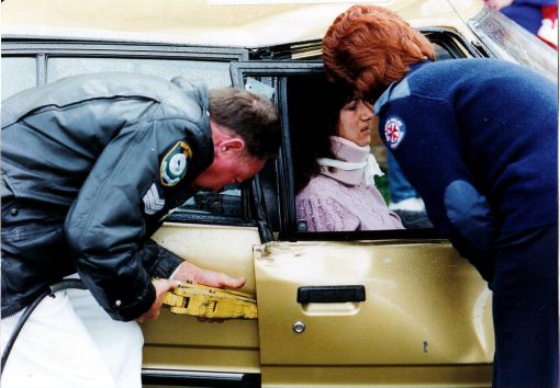John BYERS, JB, Johnny BYERS, 1990<br /> SGT JOHN BYERS WITH A/O HELEN WELLS &amp; UNKNOWN ENTRAPPED DRIVER.