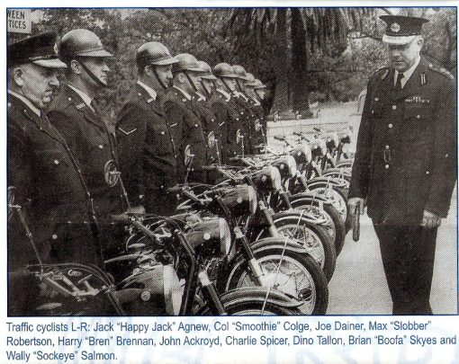 """Appears to be prior to 1968. <strong>Not all names come up in the 1968 ' Stud Book ' </strong>Inscription: Traffic cyclists L - R Jack """" Happy Jack """" <strong>Agnew</strong> ( NSWPF # ??? ), Col """" Smoothie """" <strong>Colge</strong>, Joe <strong>Dainer</strong>, Max """" Slobber """" <strong>Robertson</strong>, Harry """" Bren """" <strong>Brennan</strong> ( NSWPF # 6424 ), John <strong>Ackroyd</strong>, Charlie <strong>Spicer</strong> ( NSWPF # 7263? ), Dino <strong>Tallon</strong>, Brian ' Boofa """" <strong>Skyes</strong> and Wally """" Sockeye """" <strong>Salmon</strong>. Names are from an article in an old Retired Police Journal by Harry BRENNAN, which featured the photo. I am guessing mid 50's, leather caps have given way to black helmets and BMW's instead of the earlier Triumphs. Looks like Centennial Park - possibly on delivery of the BMW's??? https://www.flickr.com/photos/nswpoliceforce/5599527423/in/photostream/"""