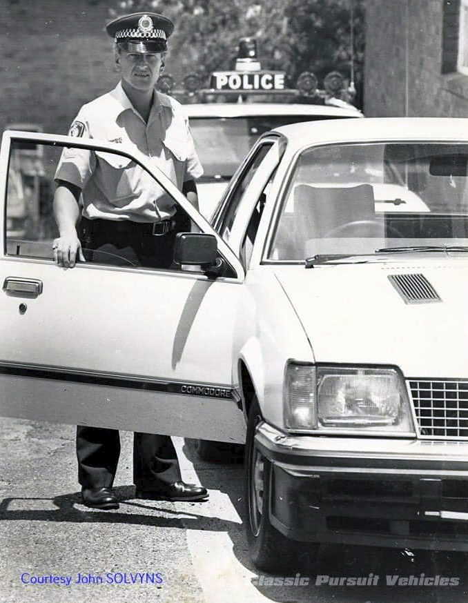 John SOLVYNS. 15 August 2017: Classic Pursuit Vehicle FB Group· John SOLVYNS sent this interesting submission through: That's me at the door. This particular VC Commodore did the rounds of a few places in NSW for trial purposes in, I think, 1983 or 84. It was supplied by GMH with a Garrett turbocharger fitted. I believe it was done in order to try and crack the HWP pursuit car market which was dominated by Ford. Apart from that I don't know too much of the technical info but there are people out there who could help. It worked very well as an unmarked car as there was an element of surprise. It didn't end well, the turbo blew and the car was last seen leaving Tamworth on the back of a truck never to be heard of or seen again. You will notice from this picture, the car had a black front spoiler and bonnet vents.