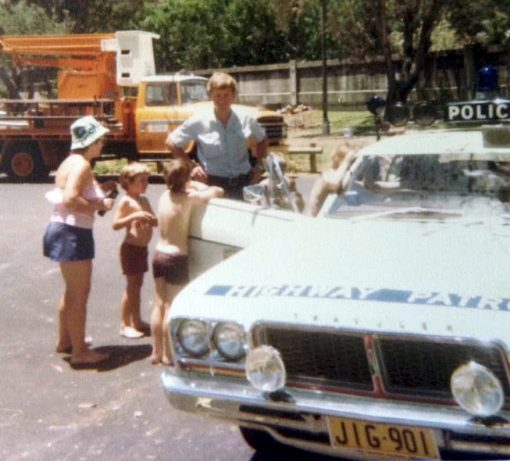 John SOLVYNS. From Col Colman: John offered his services to a local convent school picnic day, showing all the children his car. With NSWP Highway Patrol vehicle - Chrysler Valiant Charger - Regd # JIG-901
