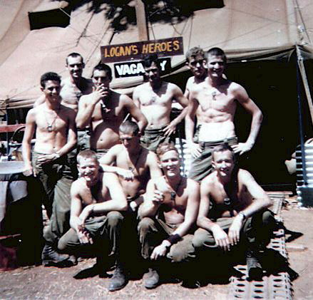 https://www.5rar.asn.au/gallery/thompson-2.htm<br /> LOGAN'S HEROES<br /> NUI DAT 1969<br /> Members of 2 Section, 2 Platoon, A Company 5RAR, posing for a group photo during a break in patrols and operations.<br /> ( Standing L to R ): Merv Tuckett, Terry Bateman, Vince Fallins, Michael Boulton, Greg Knight and Michael Skelly.<br /> ( Front ): Neville Thompson, John Riley, Norm Carrington and John Logan.