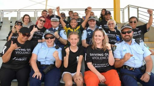Elise Marie CARTER nee Elise MONJO, Elise CARTER, Grommy. Raising awareness and showing their support during the White Ribbon Day convoy are Senior Constables Elise Carter and Dennis Hoyne with community members at Campbelltown Sports Stadium.